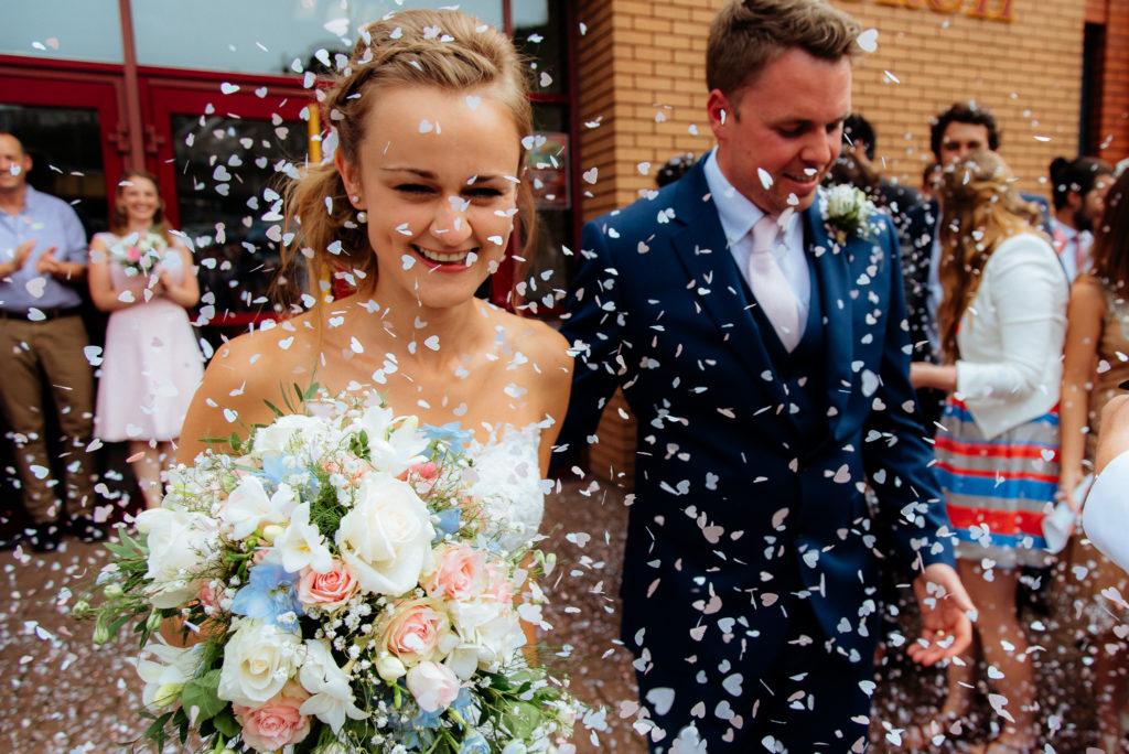 Swansea Wales wedding confetti German wedding dancing wales wedding photographer candid photographs fun photography adventurous photos