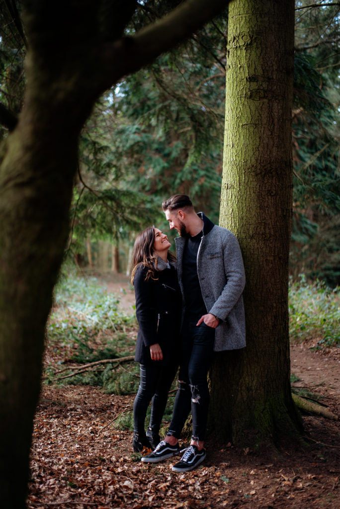 Newly engaged couple in Chantries wood, Guildford