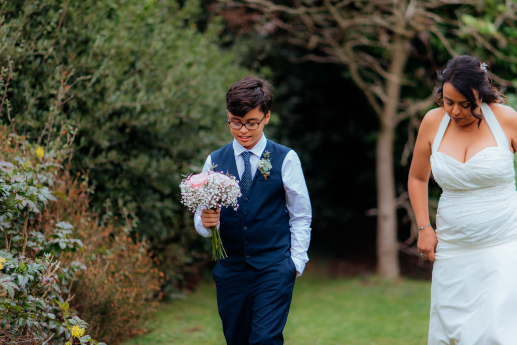 son carries mums bridal flowers