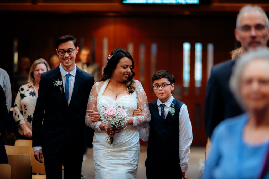 sons walking their mother down the aisle