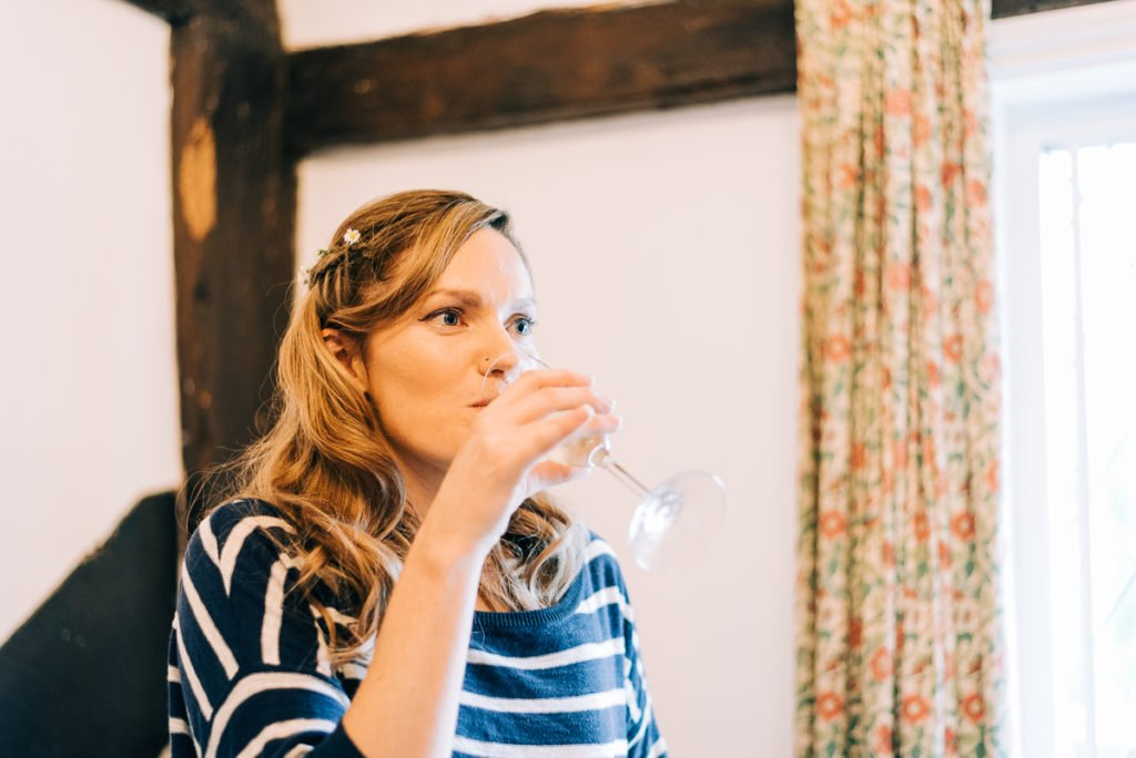 Bride drinking Champagne to ease the nerves