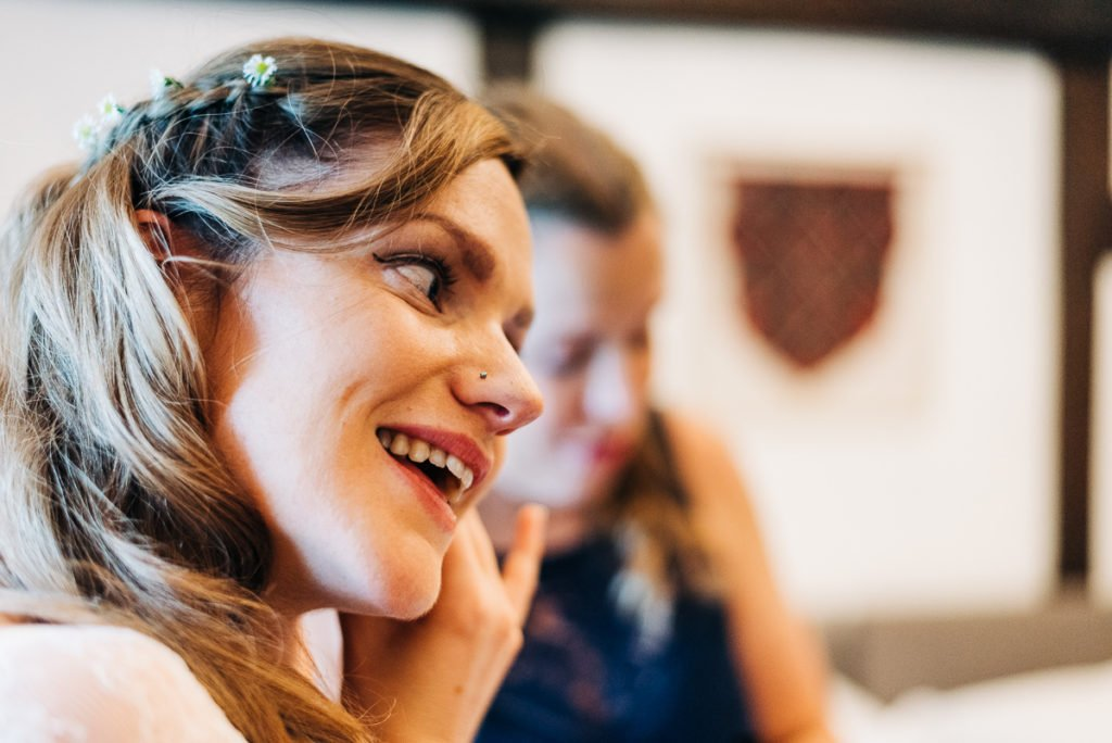 Bride puts in earrings gifted to her by the groom