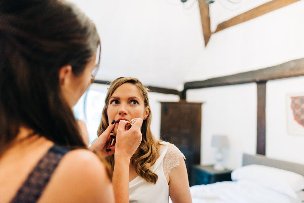 Bridesmaid doing brides make up
