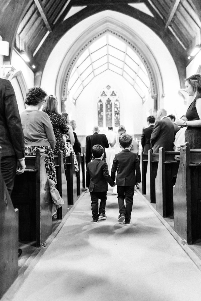 Page boys walk down the aisle