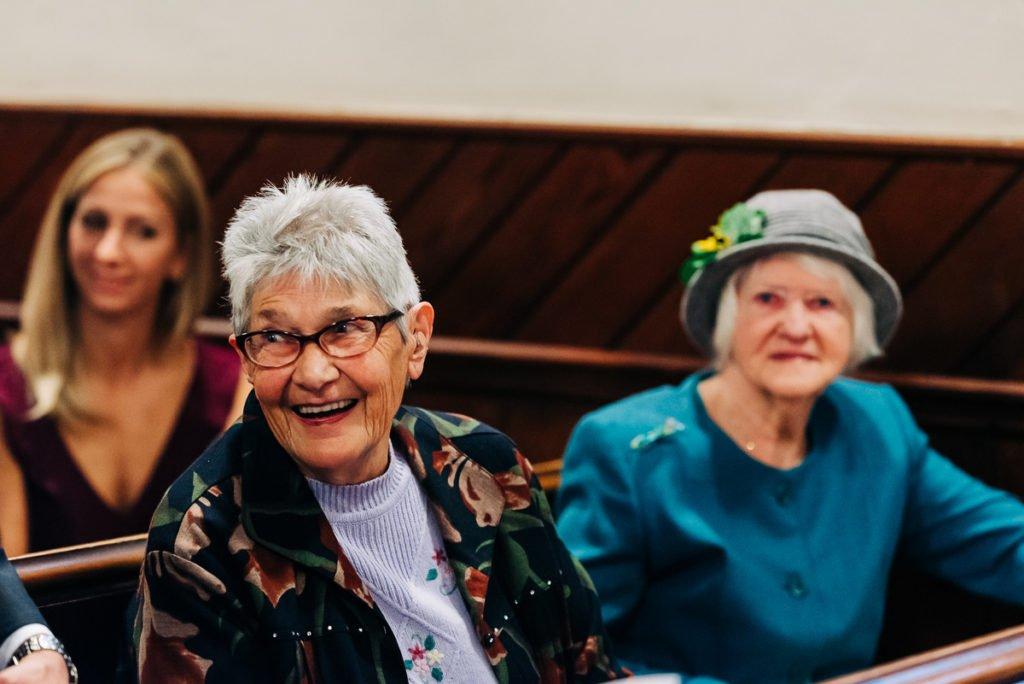 Guests enjoying church wedding ceremony