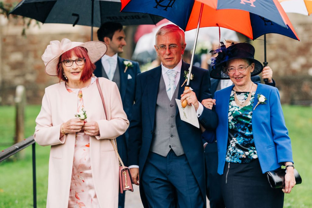 Guests leave the church in the rain