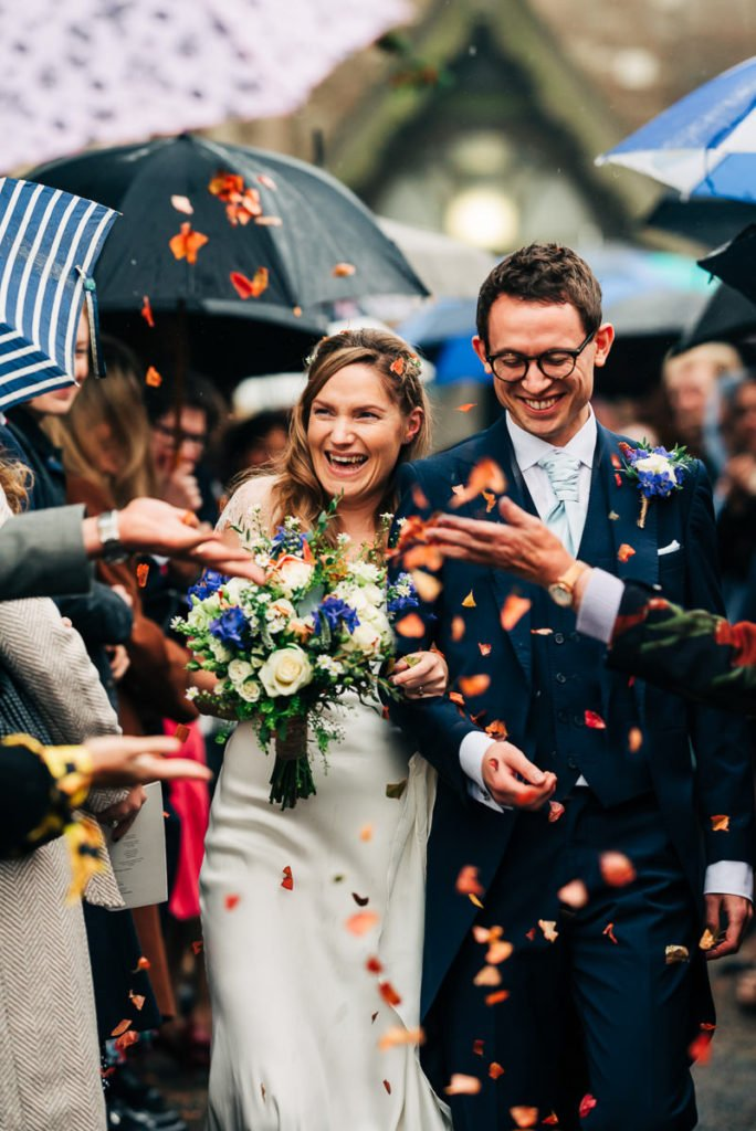 Bride and groom showered in eco friendly dried petal confetti