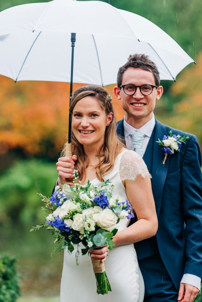 Rainy wedding day bride and groom photographs