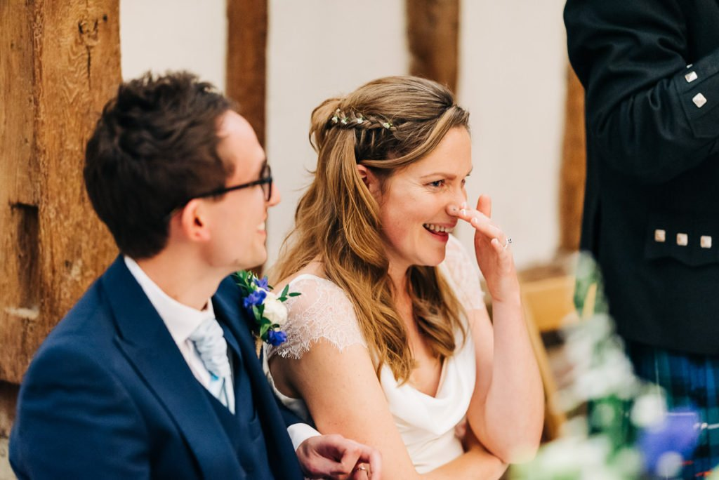 Bride laughs at dads speech