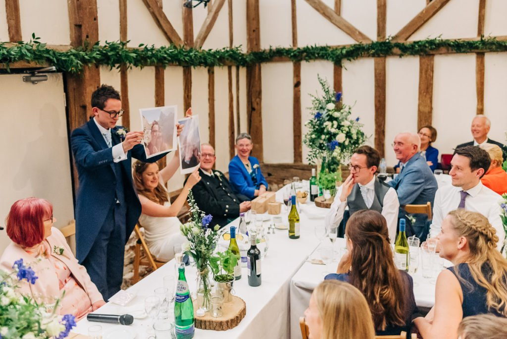 Groom uses photographs as part of wedding speech