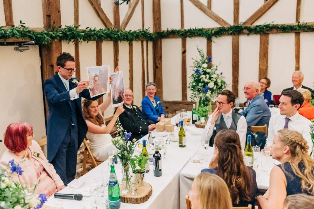 Groom uses photographs as part of wedding speech