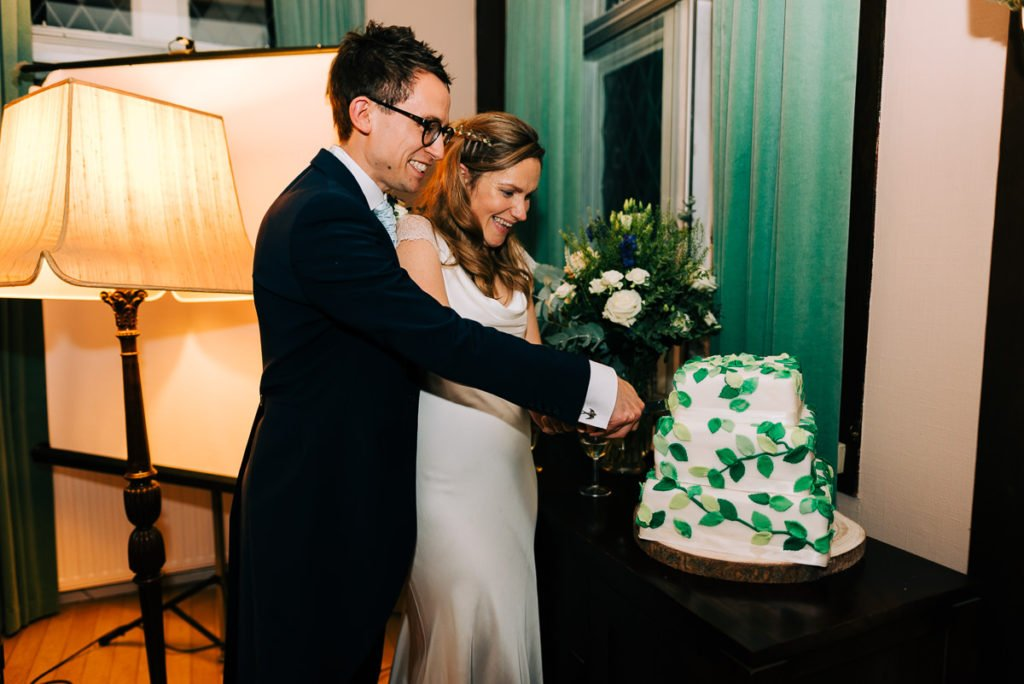 Bride and groom cut eco friendly wedding cake