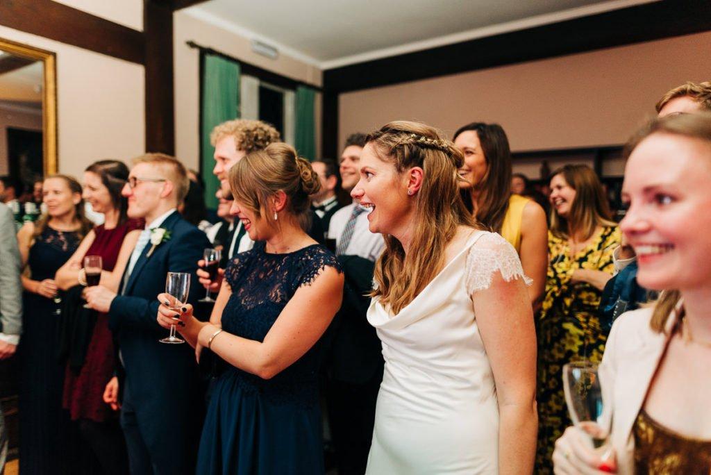 Bride laughs at groomsmen speech