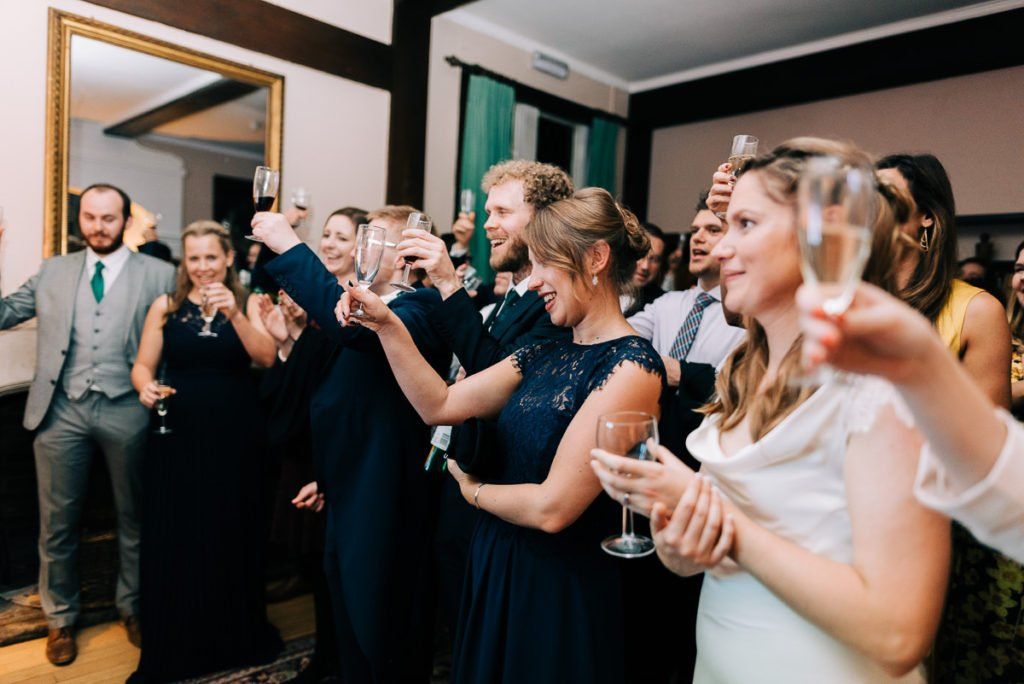 Raising a toast to the bride and groom