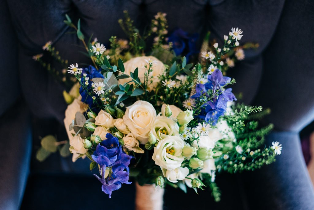 Bridal bouquet with purple and white flowers