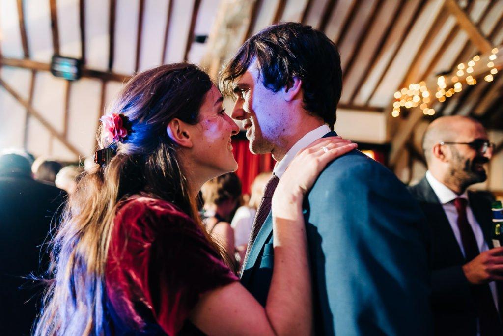 Guests join bride and groom on dancefloor
