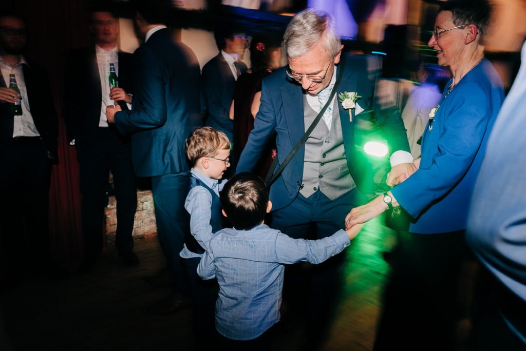 Oldest and youngest wedding guests dance together
