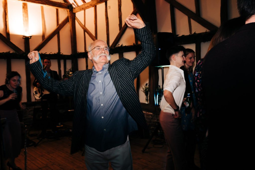 Old man funny dancing at wedding