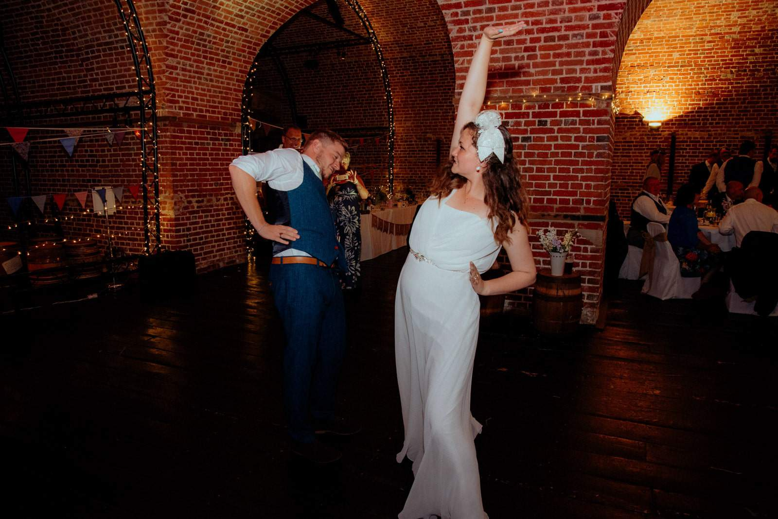 A bride and groom celebrate their nuptials with their first dance