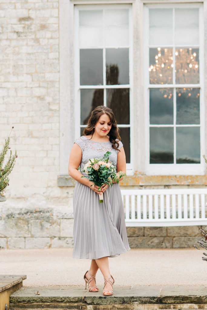 Bridesmaid enters wearing a purple dress