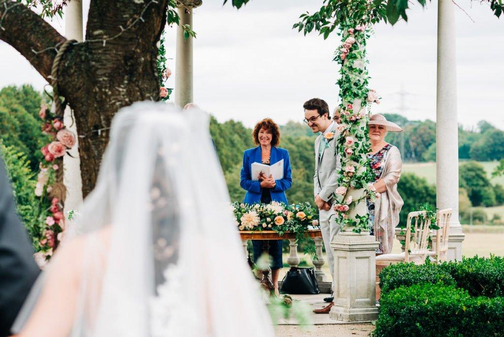 Groom looks excited as his bride walks towards him
