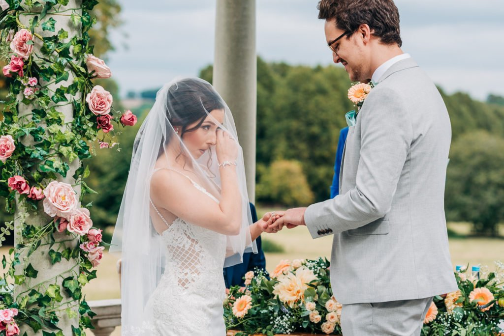Bride cries as she says her vows