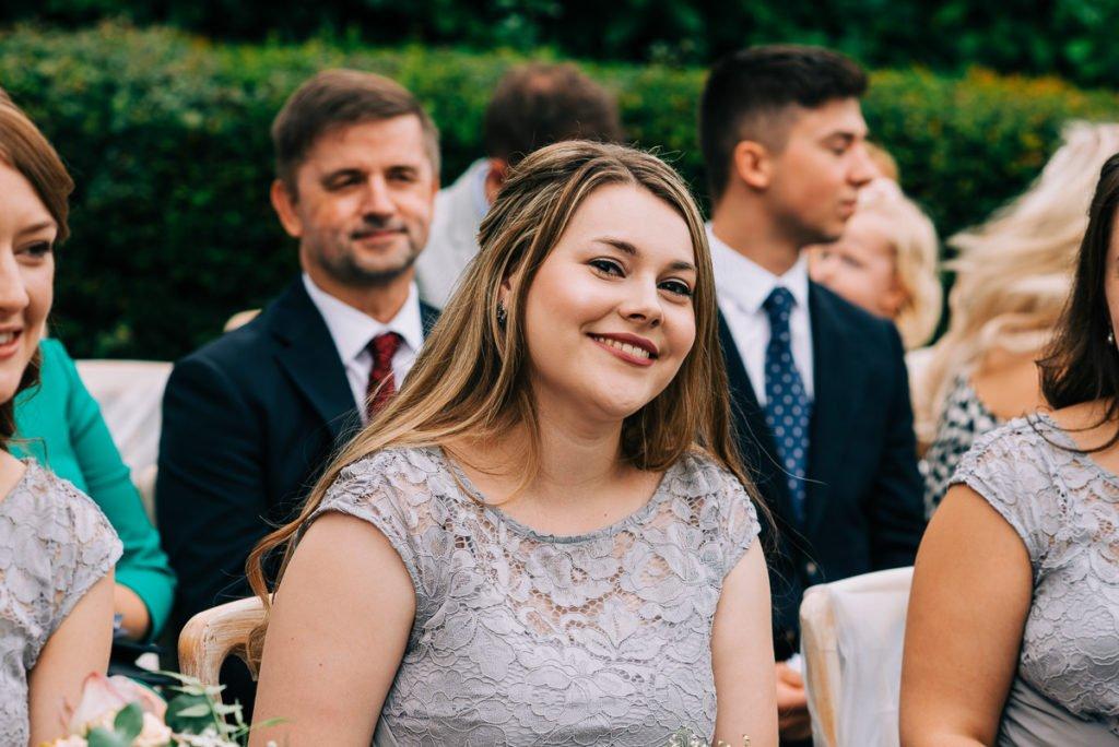Happy guests enjoy wedding ceremony