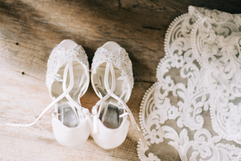 Wedding shoes and lace wedding dress train