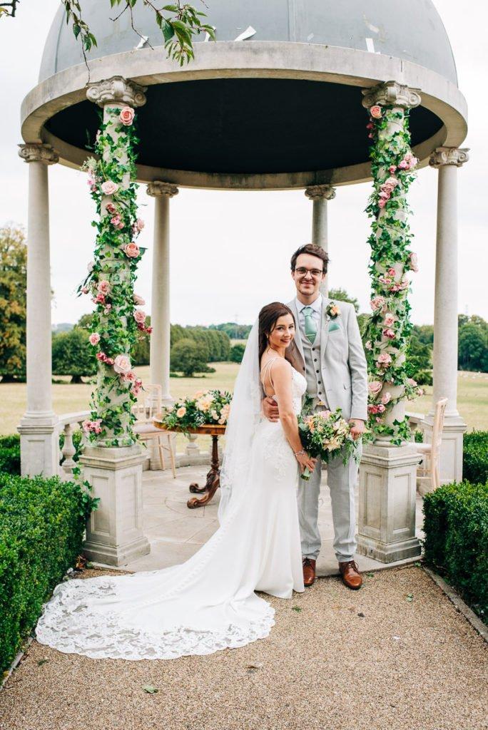 Bride and groom outdoor wedding ceremony under dome