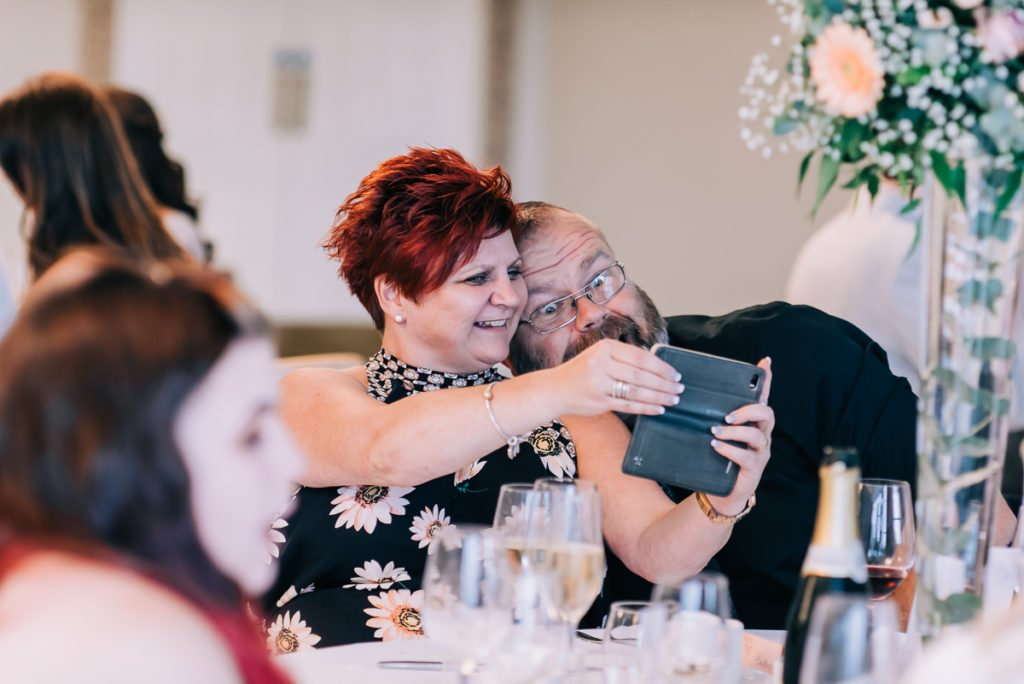 Wedding guests take a silly selfie
