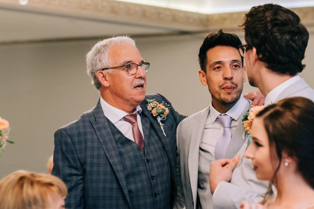 Groom talks to the wedding guests