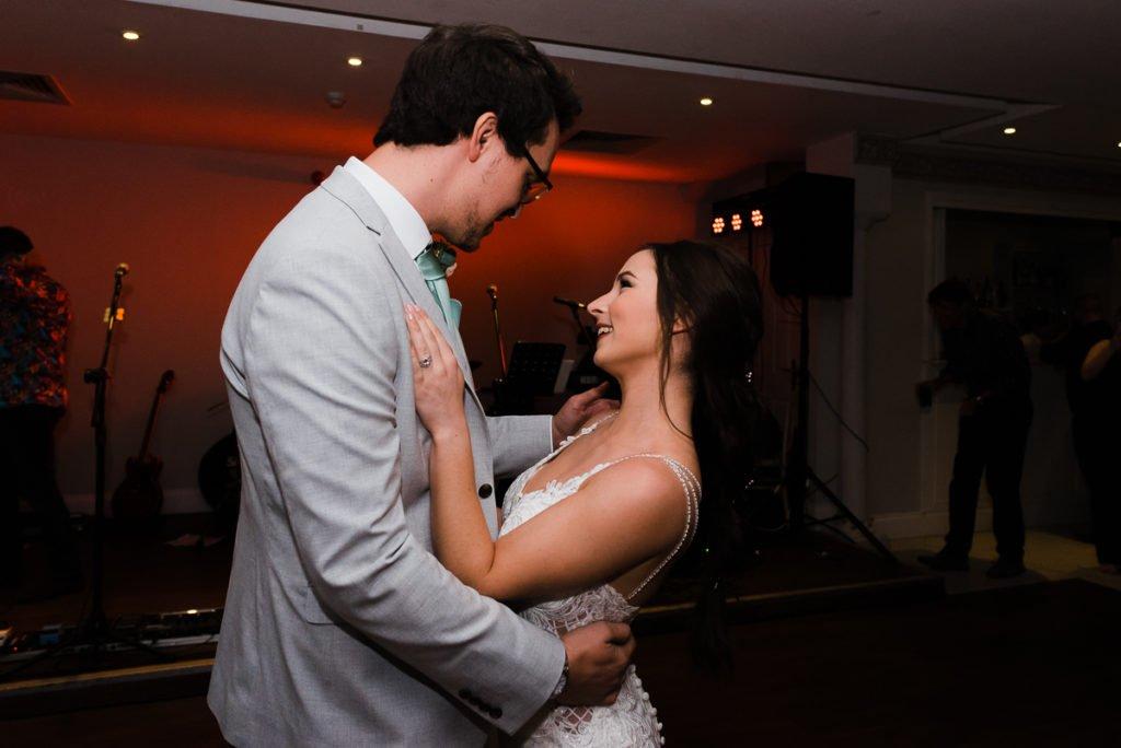 Bride and groom dance to live wedding band