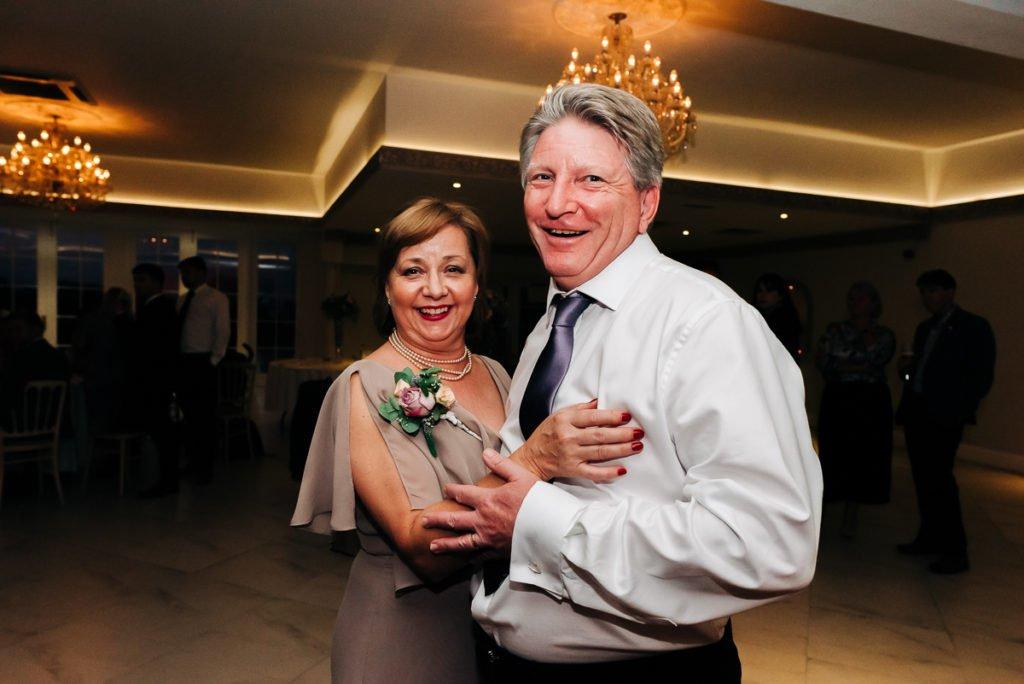 Brides parents dance at wedding