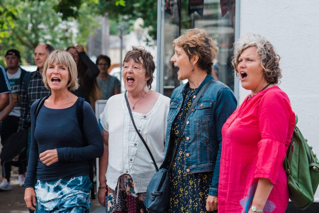 Flash mob choir start singing for wedding procession