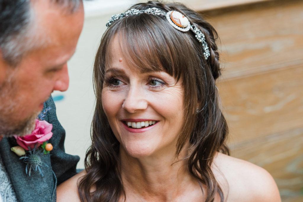 Bride looks lovingly at groom