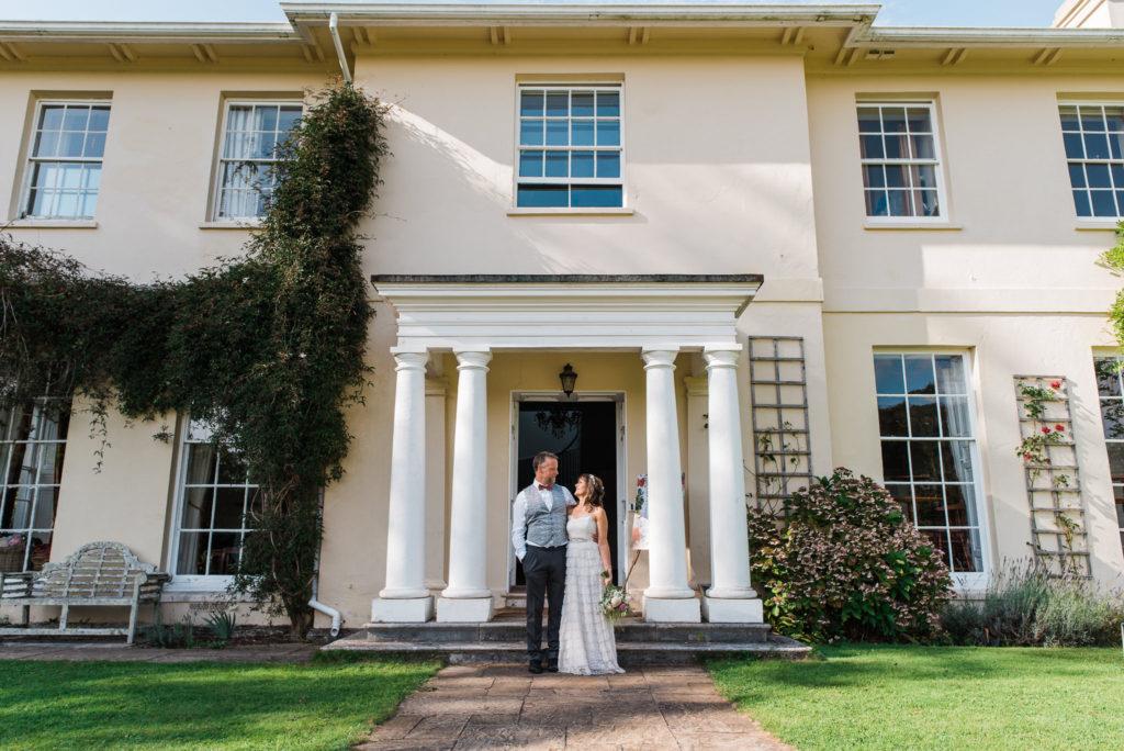 Bride and groom outside Sandwell Manor in Totnes