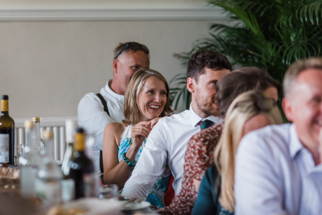 Guests laugh at wedding speeches
