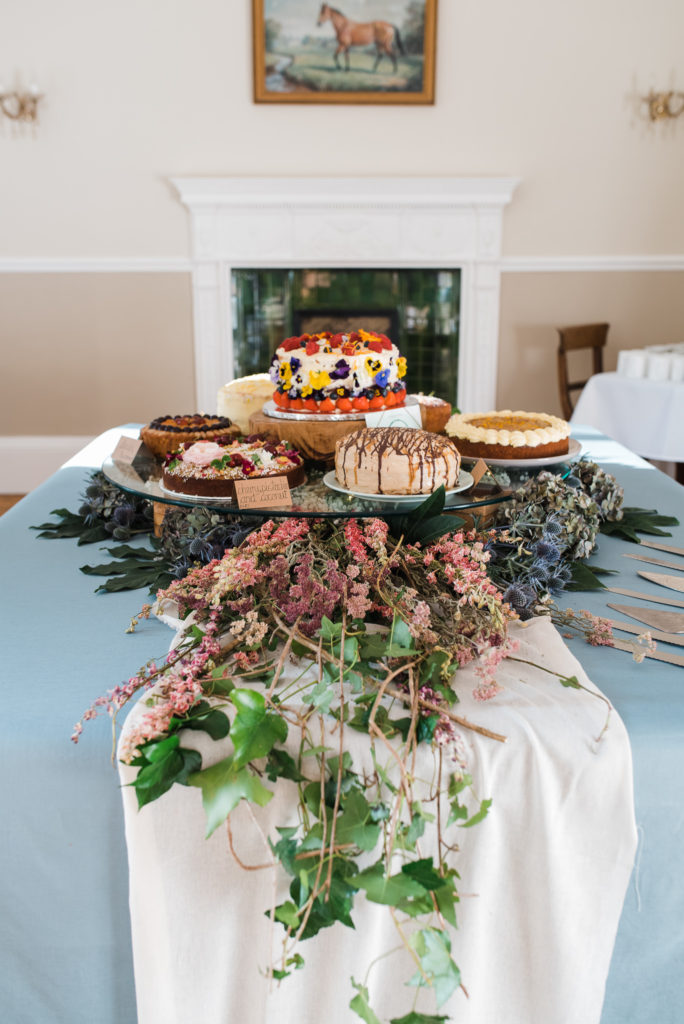 Wedding cakes displayed on a bed of flowers