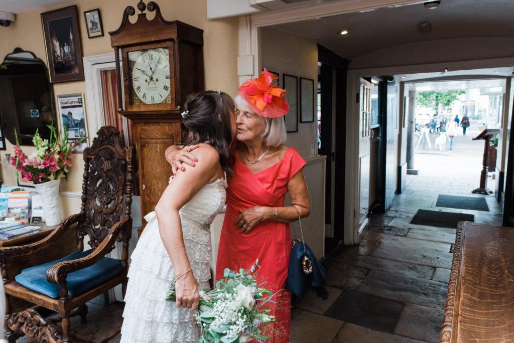 Bride and brides mother hug