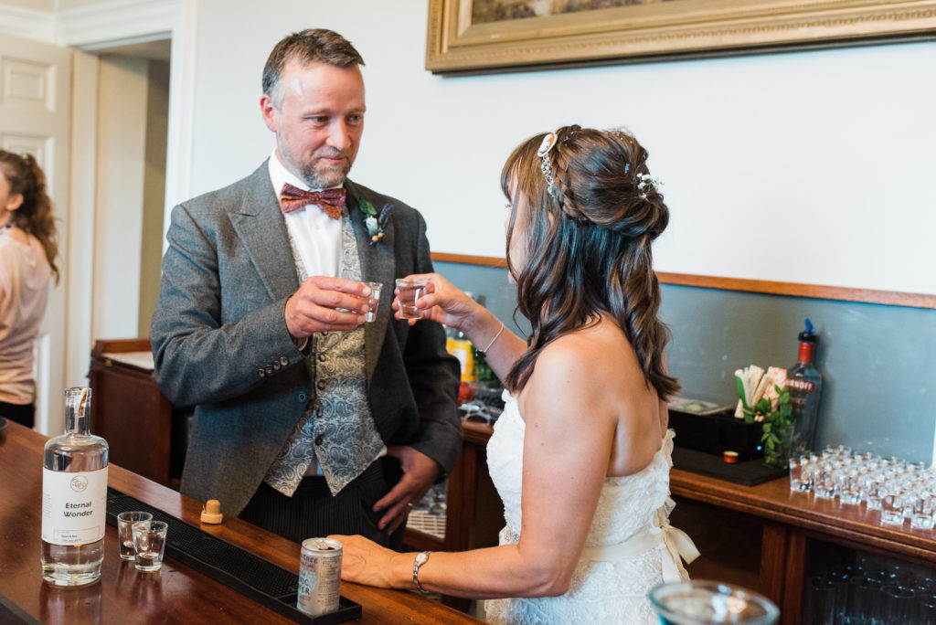 Bride and groom do a shot to get the party started