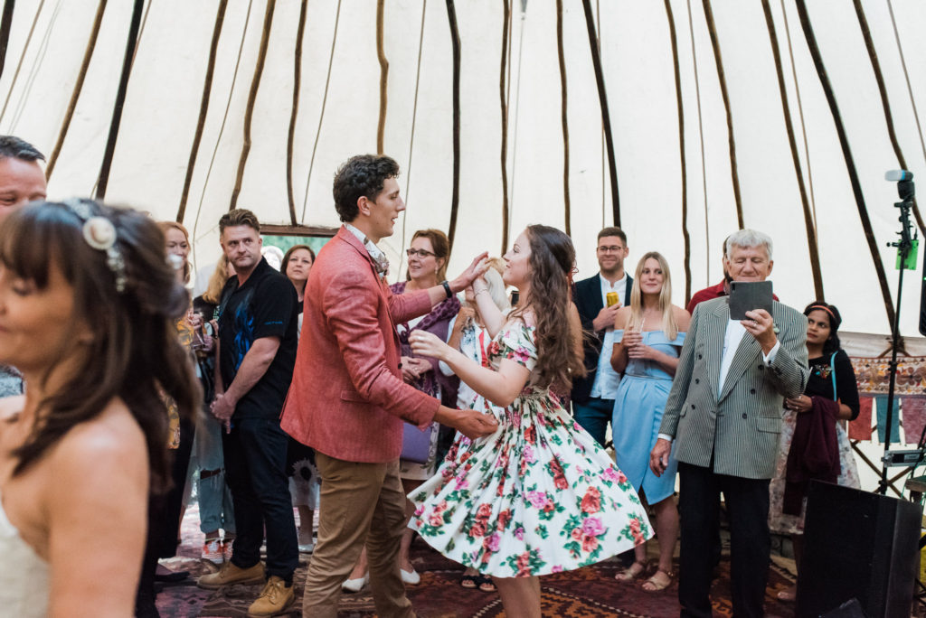 Wedding guests dance to live music