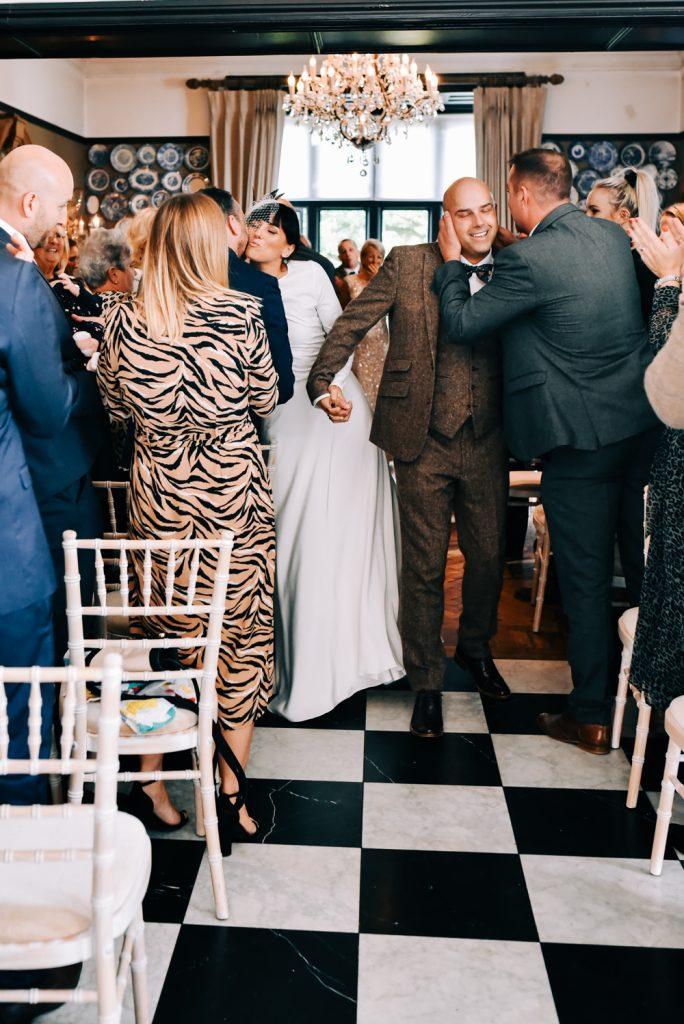 Guests congratulate newlyweds