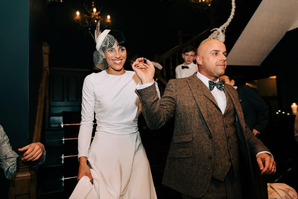 Groom leads bride to first dance
