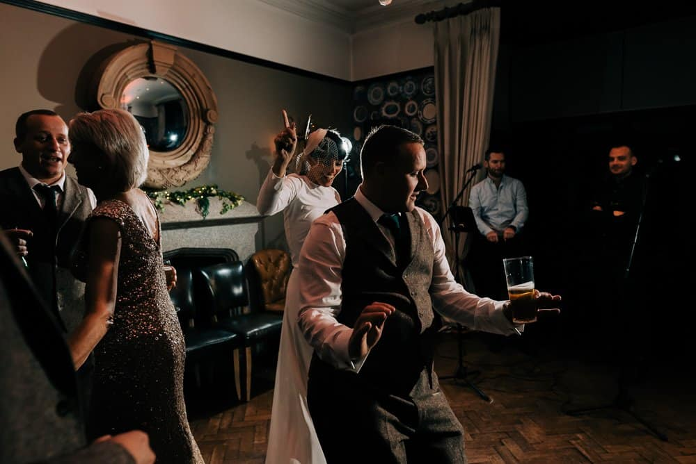 Bride and groom dance together