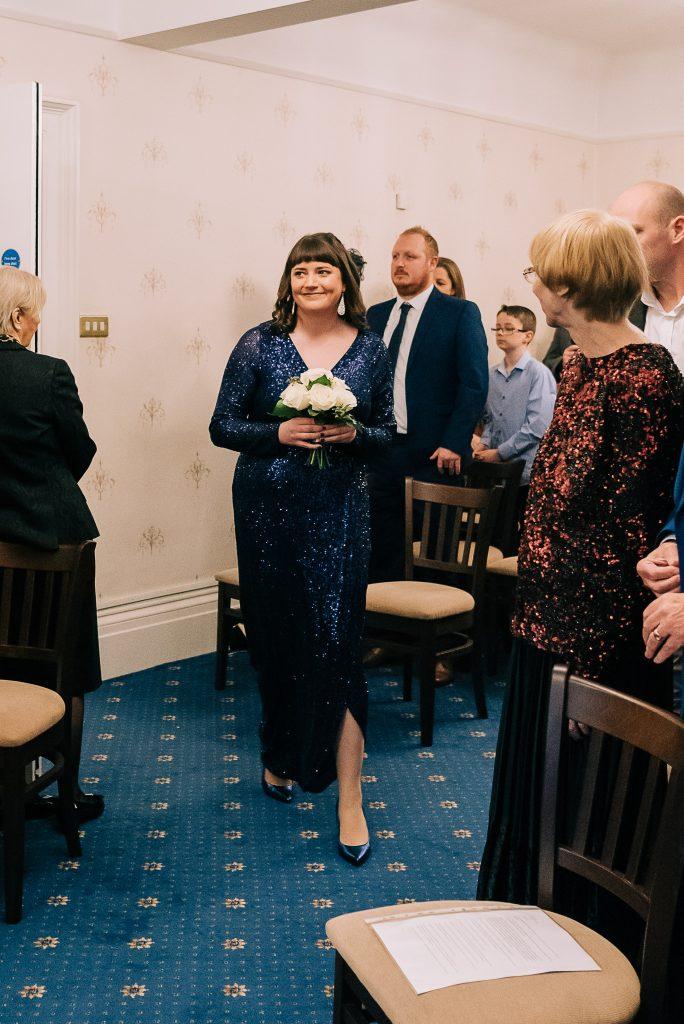 Bridesmaid enters registry office
