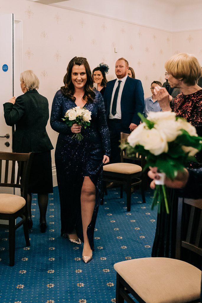 Bridesmaid enters ceremony room